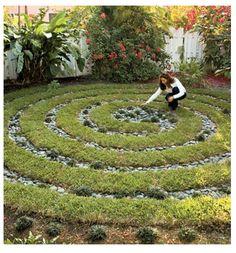 mondo grass with river rocks in a spiral garden