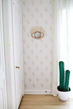 Just use a stencil (either DIY one or check out Amazon's selection) and a gold leafing pen, which you can get from Amazon for $8.33.Check out this cool cactus idea here.