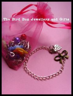 Girly DIY charm bracelet kit.  Part of the Hello Kitty jewellery box that was made for  special little girls birthday xx
