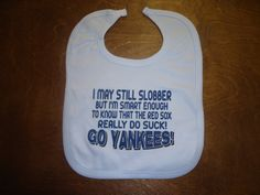 GO YANKEES I MAY STILL SLOBBER SMART ENOUGH TO KNOW THE RED SOX SUCK FUNNY ITEM TO PROTECT A SHIRT BABY BIB