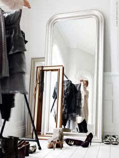 Love the look of layered mirrors -great way to bring more light into dark corners of rooms too!