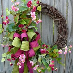 This gorgeous wreath is perfect to welcome spring and for use all summer long! Realistic greenery is adorned with beautiful high quality sweet pea