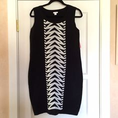 Bodycon dress So chic! It's a black dress. Bodycon style. It has a white arrow pattern going down the front of the dress. 78% acrylic and 22% polyester. Very stretchy! New with tags. Xhilaration Dresses