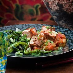 Marinated tofu with tomato and aubergine sauce and garlic greens