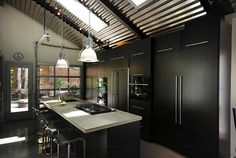 Contemporary Black Kitchen with Garage Door Opener by Renovation Design Group Industrial Kitchen Design Ideas With Modern Black Cabinets And Chandelier Kitchen Ceiling Design, Industrial Kitchen Design, Interior Design Kitchen, Modern Industrial, Kitchen Designs, Industrial Kitchens, Industrial Decorating, Interior Modern, Industrial Lighting