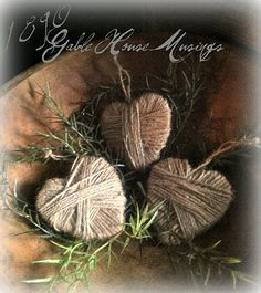 Old Wooden Bowl...filled with wrapped twine hearts & greenery.