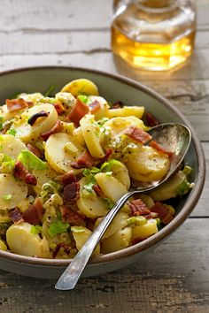 """The reassurance of potato salad has been appealing to Americans since the last half of the 19th century. German settlers brought hot potato salad, and that savory combination of warm potatoes lightly dressed with hot bacon fat and vinegar became entrenched in Pennsylvania and throughout the Midwest. This is an adaptation of a classic version that was first published in the 1931 edition of """"The Joy of Cooking."""" (Photo: Michael Kraus for NYT) http://nyti.ms/2r6Uv9i"""