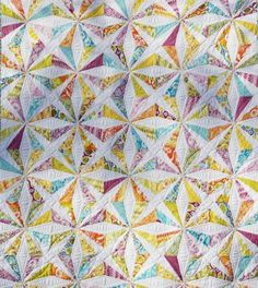 Kaleidoscope Quilt - free pattern on craftsy. Really want to make a kaleidoscope quilt. This one is lovely - the solid white really makes the fabrics pop..