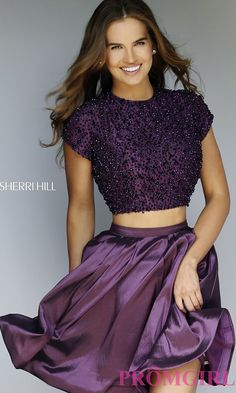 This Sherri Hill stunner will be a perfect fit for your homecoming. The cap sleeve beaded top adds a subtle touch of sparkle to this two piece dress. And with a slither of your bare midriff showing, you will want to show off this Sherri Hill homecoming dress from every angle. The flared satin skirt is perfect for a night of dancing and memories with your friends.