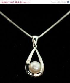 Pearl and Sterling Silver Pendant and Dangle Earrings - pinned by pin4etsy.com