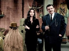 Carolyn Jones and John Astin as Morticia & Gomez Addams on the set of the Addams Family. Description from pinterest.com. I searched for this on bing.com/images