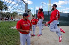 """""""Selfie Cam"""" calls out St. Louis Cardinals pitchers Joe Kelly (center) as he and Jason Motte jump up to mug for a remote time-lapse camera set up to shoot the players entering the field and exercising at the Cardinals spring training 2-18-14"""