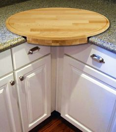 Clever idea. Corner cabinet cutting board with wide overhang. Scoot the kitchen trash can right there and scoop off peelings. Or chop and chop and hold bowl under edge and scrape directly into it