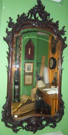 Gran espejo en madera tallada y cristal biselado. Finales del siglo XIX. 215 x 110 cm