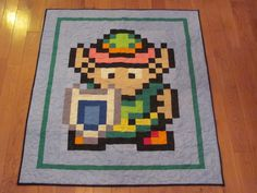 Hylian Shield Quilt Throw Size by cantustaylittle on Etsy, $180.00 ... : video game quilt pattern - Adamdwight.com