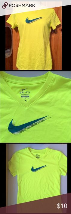 Size M girls neon Nike tee Girls neon green/yellow v-neck short sleeve tee. Could be worn as a boys shirt too. There are two tiny marks near the bottom of the shirt. Barely visible. Otherwise in great condition!! Nike Shirts & Tops Tees - Short Sleeve
