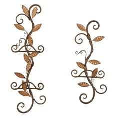 Elevate the atmosphere in the dining area or kitchen with a pair of antiqued metal plate racks. Plate rack pair holds three plates in total. Both metal racks feature single leaves and decorative scrolls to secure plates. Set of two.