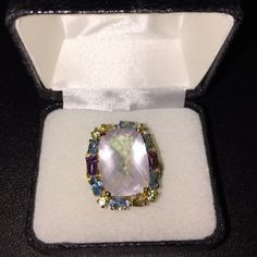 Pink Quartz & multi Gem ring NWT gold over sterling silver pink Quartz surrounded by blue topaz, amethyst, peridot and citrine. Sz 7. Retail tag 299.99 Jewelry Rings