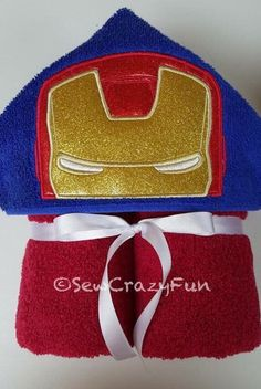 A personal favorite from my Etsy shop https://www.etsy.com/listing/274370490/iron-man-inspired-hooded-bathpoolbeach