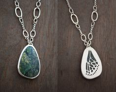 Gorgeous reversible necklace! This beautiful large green turquoise pendant features an intricate pierced butterfly wing on the back. The colors and