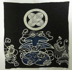 This is a vintage futon cover.  It has kamon(family crest) and takara-zukushi (treasure assortment) design, which is dyed with Tsutsugaki technique over deep deep Ai (close to black) base color