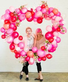 photo backdrops - Take your love of balloons to the next level with pretty inflatables shaped in the form of a whimsical heart frame. Add some flowers to the mix to keep the look wedding-appropriate