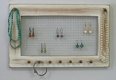 Shabby Chic Jewelry Holder Frame Vintage Shabby White Framed Jewelry Holder Earrings Necklaces Knob. $24.00, via Etsy.
