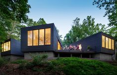 """Desiring a home in a natural setting for their three sons, ages 5, 9, and 10, architects Katie and Danny MacNelly built a three-volume residence near Virginia's James River. With a focus on outdoor social spaces, Katie likens the overall program to """"loose coals around a campfire."""""""