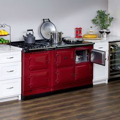 AGA Integrated Dual Fuel Module alongside the AGA Total Control 3-Oven in Claret.  Designed to integrate seamlessly with any 3-oven AGA range, the Integrated Module incorporates the joy of open flame and conventional ovens into your AGA kitchen.