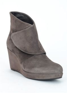 A Coclico classic the suede Henrietta has an utterly clean modern look. It sits snugly on the foot courtesy of its wide wraparound gaiter that is secured with concealed Velcro. And the boot is as comfortable as it is sleek thanks to the suede-wrapped platform wedge of recycled cork.