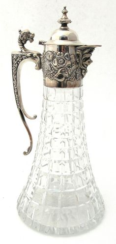 antique silver topped cut glass claret jug