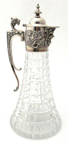 antique silver topped cut glass claret jug