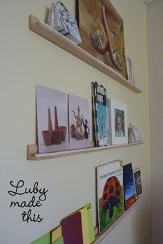 Postcard shelf.  I took L-shaped moulding and glued a .5 cm balsa wood strip along the length, creating a lip to stop things from slipping off the ledge, and then affixed with nails to the wall.  It was a quick little job and it looks really great, just right for unframed, postcardy stuff!  XX Luby