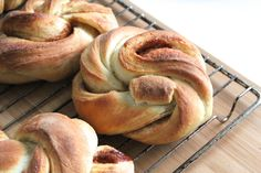 Norwegian kanelboller are a staple in every bakery and cafe in Norway. They are essentially a sweetened, cardamon scented dough, leavened with yeast and baked with a cinnamon sugar filling.