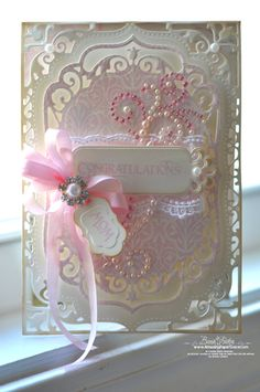 made using Spellbinders ™ Elegant Labels Four. It fit like a glove with two of the new CHA sets from JustRite Papercrafts; I used the Garden Gate Background which I stamped on the uppermost layer before die cutting. Then I also used Buntings and Banners for the tags.