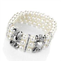 BL27210 / Three row rhodium, cream pearl and hematite colour elastic bracelet.