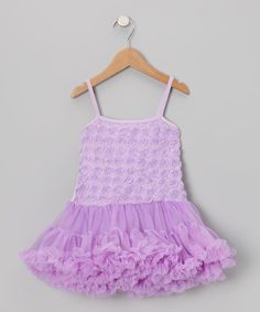 With the soft knit bodice covered in rosettes, this dress is blooming with ballerina grace. Layers of ruffles on the flouncy skirt pile atop a silky soft lining for a look that's ready to twirl!Cotton / polyesterHand washImported