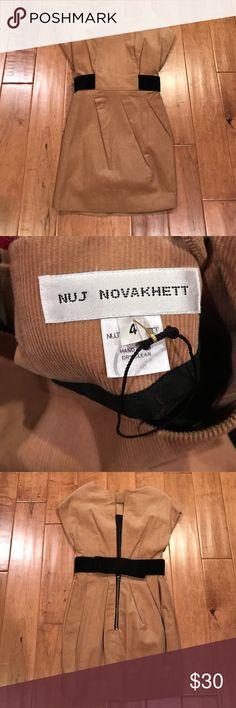 New Nuj Novakhett Corduroy Dress Tan corduroy mini dress with black bow in back. Pleating in front. Open back. Zipper at back on bottom. Never worn! By Nuj Novakhett. Nuj Novakhett Dresses Mini