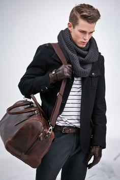 Dark Brown Leather Gloves  — White and Black Horizontal Striped Crew-neck T-shirt  — Black Military Jacket  — Charcoal Chinos  — Dark Brown Leather Belt  — Dark Brown Leather Briefcase  — Charcoal Scarf