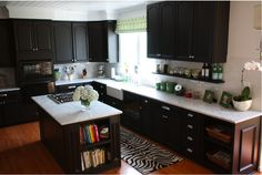 Dark cabinets with marble counters