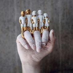 gioielli in ceramica e oro anelli