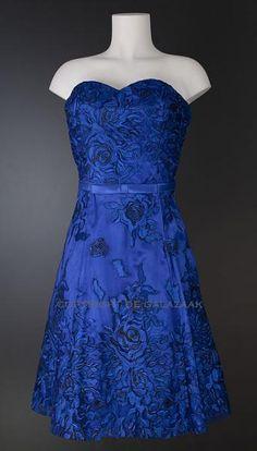 Niet mooi, maar middelbaar goed. Iets langer en lichter Blauwe Cocktailjurk met kanten rozen 2148