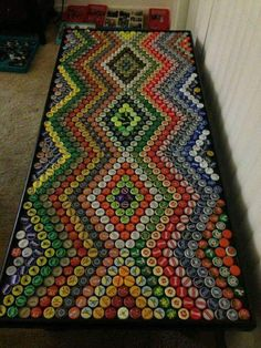 Bottle cap crafts is a fantastic way to make the most out of a bottle top collection that you& not sure what to do with. The type of art . Beer Cap Art, Beer Bottle Caps, Bottle Cap Art, Beer Caps, Beer Bottles, Beer Pong, Bottle Top Crafts, Bottle Cap Projects, Bottle Top Tables