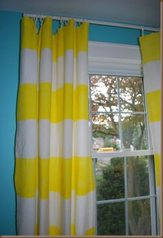 Painted stripe curtains.  Liked this idea so much that I made them for my own living room.  Regular house paint also works well for this project