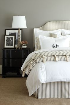 15 nuetral bedrooms that are anything but boring   Gray bedroom with ticking stripe bedding and headboard