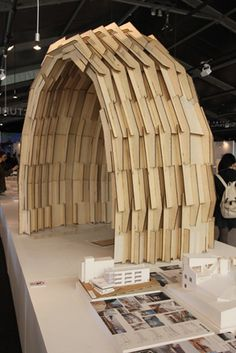 The curved plywood model by Hirose Daisuke, who established Archicomplex in 2005. The structure was assembled without any glue, nails or screws. The designer wanted to create a weatherproof hut suitable for disaster sites that could be built in just a few hours, so he developed an envelope with finger joints of plywood panels (cut by laser cutter)! wow!    Tokyo design fair report, 2012 | Design | Wallpaper* Magazine: design, interiors, architecture, fashion, art