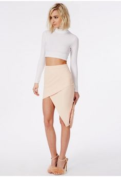 """Simple yet effective, this asymmetric midi skirt will make any outfit. Work the nude trend with this sleek skirt. Simply team with a crop top, strappy heels and envelope clutch.  Approx length 67cm/26.5"""" (Based on a UK size 8 sample)  M..."""