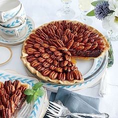 Salted Caramel-Chocolate Pecan Pie | A cross between a fudge pie and pecan pie, this is all the more stunning if you arrange the pecans from the center in a spiral pattern.