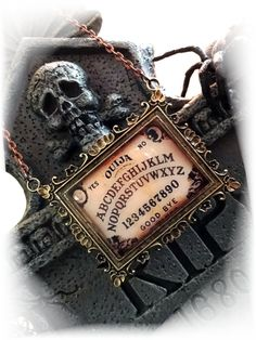 Vintage Ouija Board Necklace for Halloween.