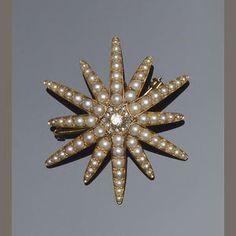 A Victorian diamond and half pearl star brooch Estimate: £500 - 600 US$ 760 - 910 €590 - 710